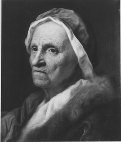 Portrait of an old woman with fur