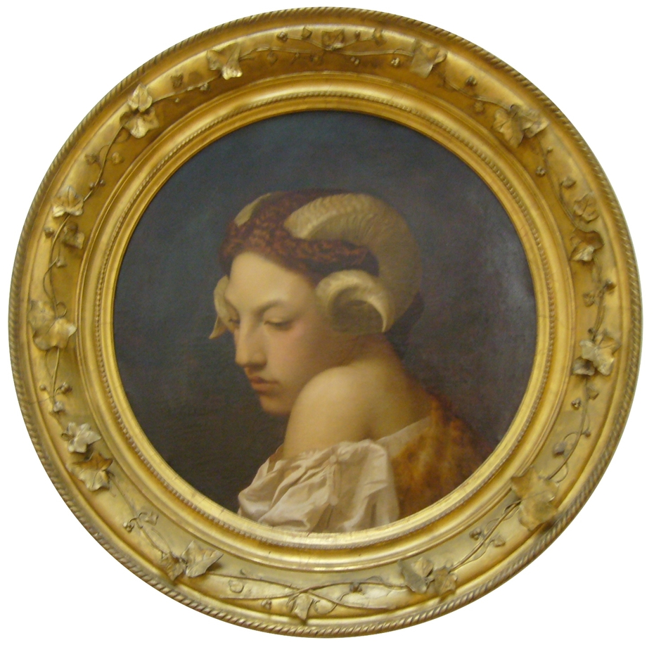 Tête de femme coiffée de corne de bélier