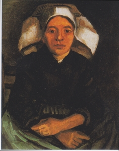 Peasant woman, seated, with a white hood