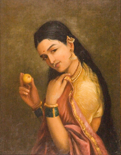 Woman Holding a Fruit