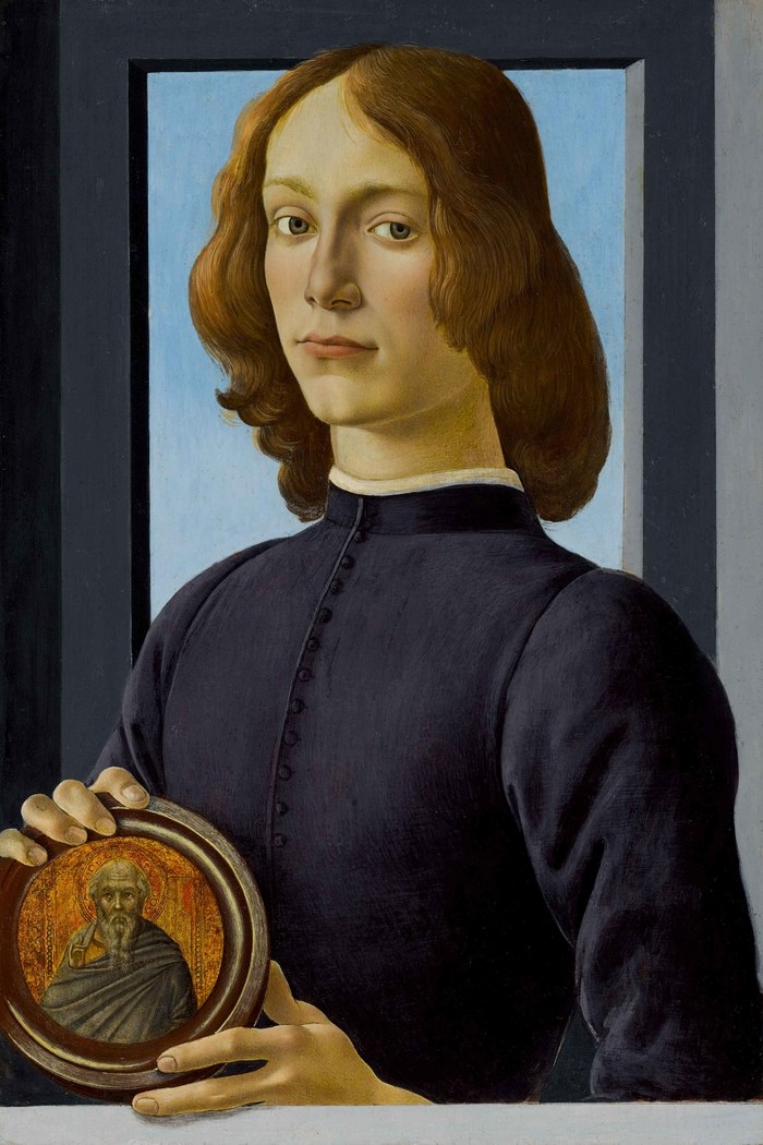 Young Man Holding a Roundel