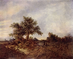 Dune landscape with a man and a boy walking towards a town