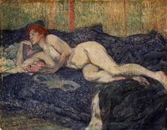 Naked woman stretched on a couch