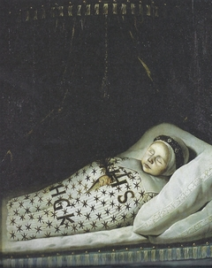 Portrait of a dead child wearing a mourning wreath around its head