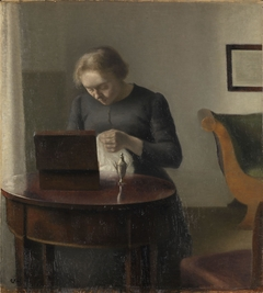 The Artist's Wife at a Sewing Table