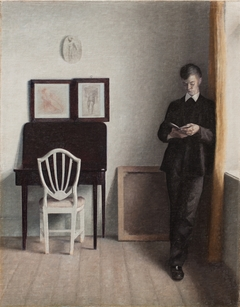 Interior with a Young Man Reading