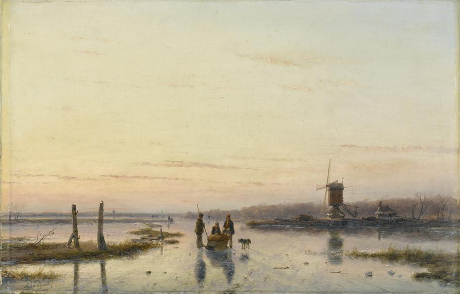 Windmill beside a frozen river