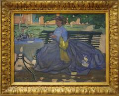 Woman at a garden table