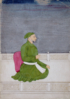 A courtier in a green jama and turban