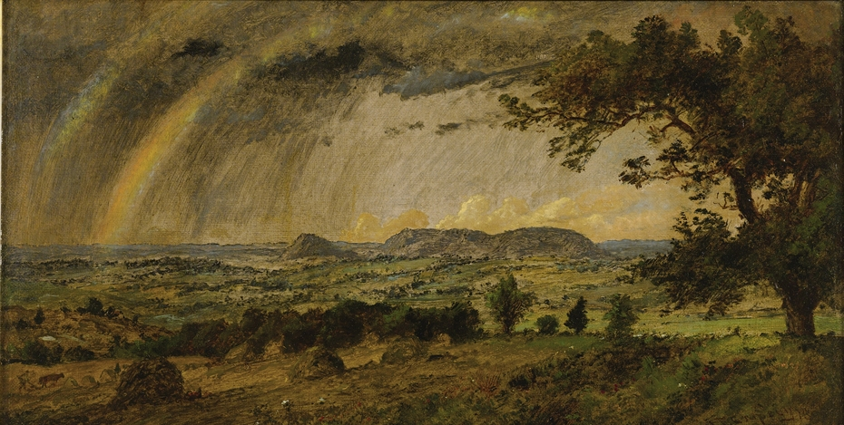 A passing shower over Mts. Adam and Eve