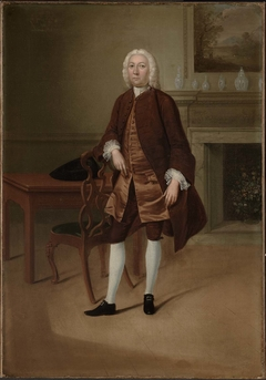 Portrait of a Man Standing Beside a Table