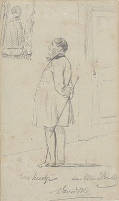 Staande man die een schilderij aan de wand bekijkt
