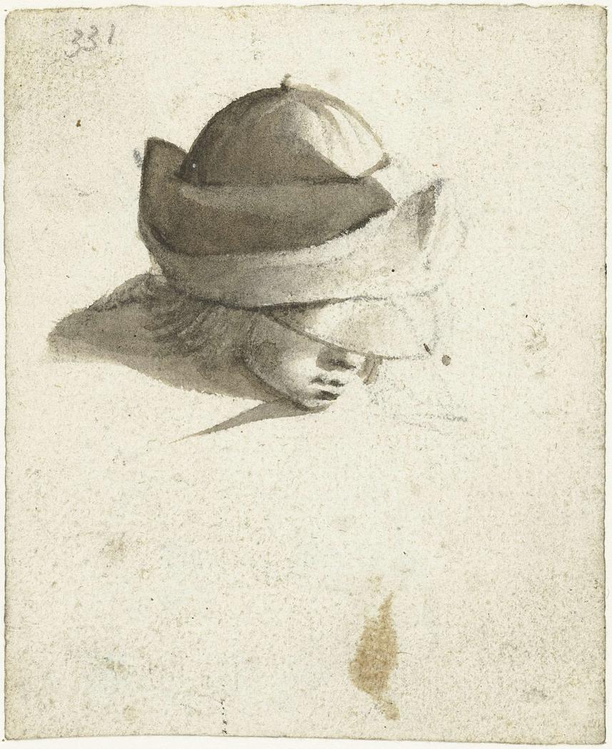 Studieblad met kop van een jongetje, van bovenaf gezien