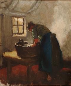 Vrouw aan de wastobbe