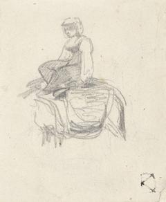 Vrouw zittend op de rug van een ezel